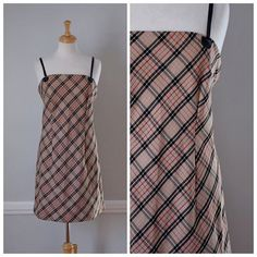VINTAGE 70s PLAID SPAGHETTI STRAP DRESS   Made by DBY this dress is strait sheath style with side bust darts, front tucks, back tucks, and a full back invisible zipper. The straps are made of faux black leather. The print is a popular plaid still used in many contemporary garments. This dress looks lovely by itself or worn as a jumper.    Item: 70s Plaid Spaghetti Strap Dress    Material: Polyester, Rayon    Size: Junior size 11/12, estimated to fit like a modern womens 10-12    Color(s)...