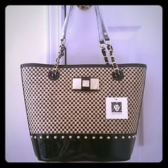 "Anne Klein Checkmate Black Patent Straw Tote Brand new, ✔never carried, with tag still on, sophisticated graphic checkboard pattern. Very elegant in person! The straw and black patent leather combination of the exterior is a highlight plus the gold tone studs and bow logo plaque made it more gorgeous. Interior is fully lined with black polka dot fabric with middle zipped compartment. Magnetic snap closure, strap drop 9"". Perfect for spring and summer! ✔Absolute flawless condition. Offers…"