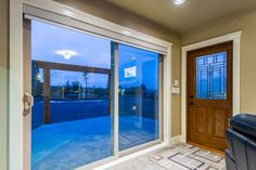 Excalibur Custom Home | Nanaimo | Ridgeview Place -  entrance with french doors to patio