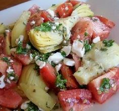 "Artichoke & Tomato Salad: ""This was a delicious way to make use of my summer tomatoes! It made a great side dish for our grilled seafood dinner."" -JackieOhNo!"