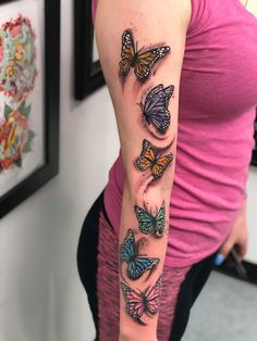 Six beautiful colored butterflies on arm