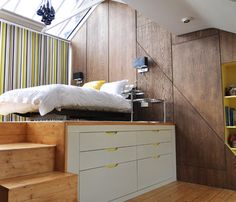 A slightly elevated loft bed creates enough storage underneath for an entire wardrobe.