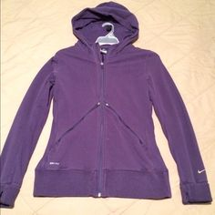 Nike Dri-Fit full zip hoody Shows signs of wear but still in good condition. I've pictured the little stains on the front. Feel free to ask any questions. This hoody has super cute style to it. Nike Jackets & Coats