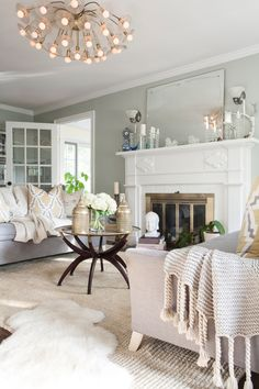 #lighting, #fireplace, #mantel, #living-room, #chandelier, #coffee-table, #paint-color, #neutral, #mirror, #walls, #cozy, #flea-market  Photography: Ayla Christman - aylachristman.com Design: Courtney Donnelly - courtneydonnelly.net/  Read More: http://www.stylemepretty.com/living/2013/05/20/the-donnelly-residence-from-ayla-christman/