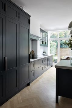 Modern Kitchen Interior Remodeling - Anyone planning a black kitchen design is walking a tightrope throughout the design process because even the smallest mistake can […] Black Kitchen Cabinets, Black Kitchens, Luxury Kitchens, Cool Kitchens, Dark Cabinets, Kitchen Black, Kitchen Island, Classic Cabinets, Gold Kitchen