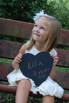 Cute idea, to get your child to write their name & age every year holding this chalkboard sign x