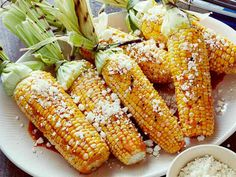 Grilled Corn on the Cob with Chili-Lime Butter and Cotija Cheese recipe  via Food Network
