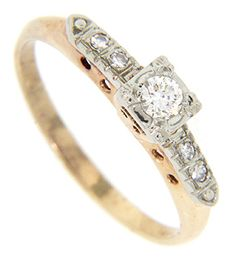 Diamond duos adorn the shoulders of this 14K bi-color vintage engagement ring. A faceted round diamond is set in the center of the ring. White gold overlays yellow gold on this retro-modern ring. The ring measures 4.2mm in width. Circa: 1940. Size: 5 3/4. We can resize.