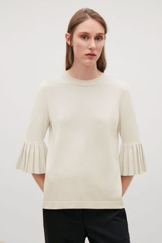 COS | Knitted top with pleated sleeves