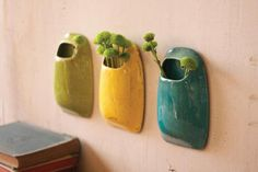 set of three ceramic wall hanging pocket vases.. just an idea.. glaze in and out and use to grow pathos plants in gravel/water.