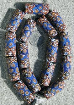 African Trade Beads.  A strand of 15 scarce tubular shaped Venetian millefiori beads dating to the late 1800's to the early 1900's and used for the African trade.