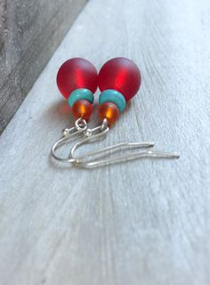Red sea glass earrings. An eye-catching pair of earrings made of sea glass and dyed turquoise howlite beads dangling on your choice of either silver