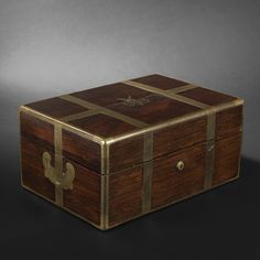 Dujat, Palais Royal, Paris. Case, 19th Century    Brazilian wood dressing kit case with brass fittings. Lid monogrammed M.    Work from the firm Louis Dujat, successor of Smal, Galerie Montpensier in Palais Royal, Paris.    19th Century.    Height: 16 cm (6-1/4 in.) - Width: 34,5 cm (13-1/2 in.) - Depth: 24,5 cm (9-1/2 in.).