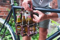 Bicycle Beer Carrier Leather beer holder connects to the frame of your bicycle. Securely fastens to the seat tube and top tube. Hands free way to deliver precious six pack.