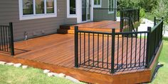 Deck with metal rail (and metal posts). These posts come up a little high though.