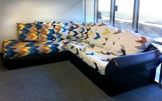 spoonflower's clever use of their fabric on their office couch.