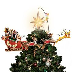 Capture the fond memories of Disney holidays past with this illuminated, rotating Disney tree topper, available from The Bradford Exchange Every sculpted detail is meticulously hand-cast and hand-painted by expert artisans At the flip of a switch, Tinker Bell, Mickey with his sleigh full of vintage-inspired Disney toys and Pluto actually rotate around the star