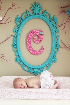 Adorable spray painted frame with scrapbook covered letter for sweet baby's nursery!
