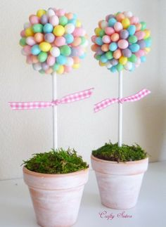 Jelly Bean Topiary. This cute and romance themed jelly bean topiary adds a fresh spring flavor for your Easter decoration. Glue each jelly bean onto a pink Styrofoam ball add floral foam to anchor the dowel into and cover it with moss. http://hative.com/creative-easter-outdoor-decoration-ideas/