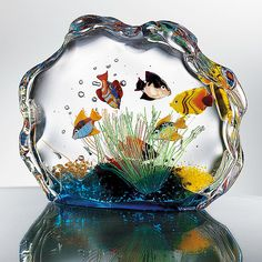 "Murano Glass Aquarium | $199.95 ($220) | Experience tranquil pleasure of tropical fish aquarium w/o need for feeding/maint. Beautifully expressing strong tie betw tiny islands of Venice/briny lagoon they reside in, handmade by glass blowers; fish/reeds/decorations created from glass rods, called murrina, then skillfully embedded (while nearly molten) w/in glass ""tank"" of enchanting Aquarium; result is masterful illusion of movement made more vibrant/magical in natural light; approx. 5""h. x…"