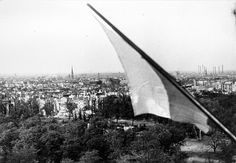 """Polish flag over Berlin, May 2, 1945. The first set of volunteers Warsaw infantry division """"Tadeusz Kosciuszko"""""""