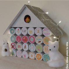 Calendrier de l'Avent : maison avec des rouleaux de papier toilette