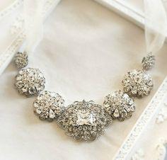 Vintage Four Carat Cushion Cut  Diamond Surrounded by Twenty   Two Carats of Round Diamonds.  of Round Diamonds.