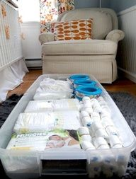 Under crib storage hidden with crib bed skirt. 9 Easy Nursery Organization Ideas | TheBump Blog