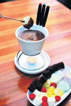 Out of the Blue @Le Sutra Hotel in Khar (Mumbai) serves the traditional Swiss fondue and also takes it to the next course -- Dessert. The chocolate fondue is a bowl of decadent dark chocolate on a slow burner melted to perfection. Dip some Exotic Fruits, Brownies or Marshmallows in the chocolate, for a perfect end to the meal :) Swiss Desserts, Fun Desserts, Swiss Fondue, Exotic Fruit, Marshmallows, Continents, Chocolate Fondue, Geography, Mumbai