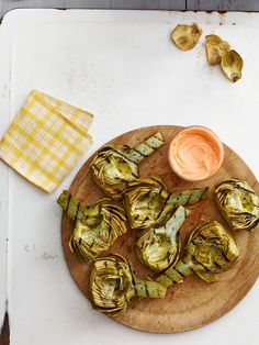A+little+sweet,+smoky,+and+spicy,+these+simple+grilled+artichokes+make+an+unexpectedly+delicious+appetizer+or+party+dish. Recipe:+Grilled+Artichokes+with+Harissa-Honey+Dip   - CountryLiving.com
