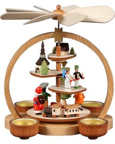 Multi-tier Christmas pyramid featuring a Toy Village. From the Dregeno cooperative in Germany's Erzgebirge.