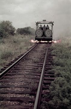 Men ride a weed-burning rail car in Texas, June 1941. Photograph by Luis Marden, National Geographic
