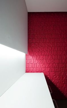 Wooden alphabet attached to wall then painted a color; Idea based on design by Davide Groppi: