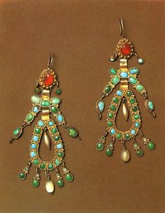 Earrings, Uzbekistan. 19th century. Silver, with granulation; cornelian, turquoise and mother-of-pearl. Length 12 cm.