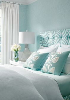 Gorgeous coastal blues in the aqua blue and white bedroom