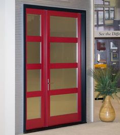 A contemporary-designed entrance door with frosted matte glass. Kolbe Ultra Series.