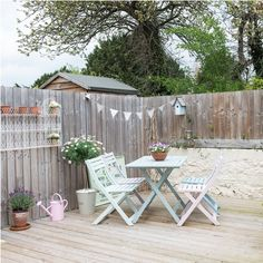 Urban garden and no grass? You can still create something pretty with painted outdoor furniture, accessories and bunting