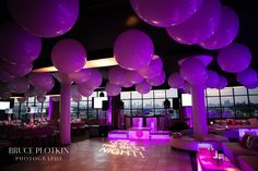 Purple balloons and decor for a Bat Mitzvah.