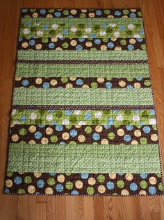 Simple strip quilt for a baby boy. Five different fabrics.