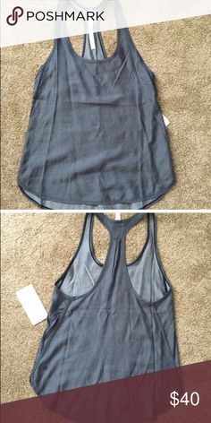 Lululemon principal tank Great condition tank! Blue chambray color! Work twice lululemon athletica Tops Tank Tops