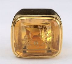 18K GOLD AND CITRINE INTAGLIO RING  Weighing 10.6 dwts. Size 7. $1200