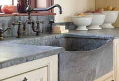 Pros: This rustic, farm-chic surface is basically non-porous, meaning it won't trap germs and stains. Cons: Since Soapstone is soft, it can be prone to nicks and dents.  Price/Sq. Ft.: $70 to $130
