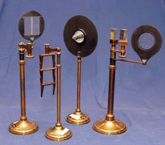 Prisms have been standard laboratory equipment since Isaac Newton used one in 1666 to study the nature of the spectrum. The three prisms hanging from the brass stand may be folded up in pairs to demonstrate achromatism (no color separation) or constant deviation (no color dependence of the angle of minimum bending of light). These were made by Lerebours et Secretan of Paris, and are listed at 50 francs in the 1853 catalogue.