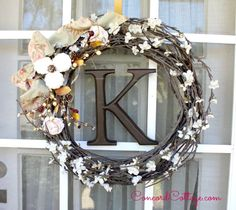 Fall Monogram Wreath you can make by adding flowers, branches and fabric.  I painted the pink flowers white.
