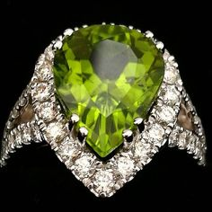 I am so loving this setting! Can look all sides and even upside down and still so nice!! Center stone peridot in 5,5 ct