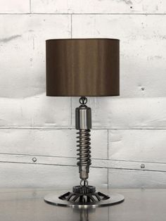 Old Motorcycle Parts as a lamp. Cute for a boys nursery
