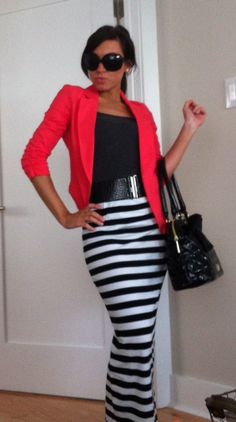 Diva. coral/red blazer, black top, wide black belt, striped maxi