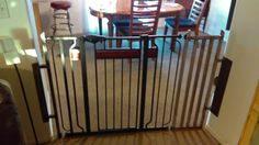 I made extension wings for this gate to keep our grandchild out of the kitchen. Works good, I'll paint it in the spring.