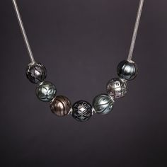 8010NT: With seven assorted hand-carved Tahitian Pearl Queen Beads. Also available in white freshwater.