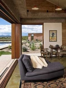 Pioneering the way for sustainable homes in Santa Fe, New Mexico, the Milder residence blends beautiful adobe architecture with elegant touches of modernism. Conceived by Boston-based Signer Harris Architects, the stunning off-grid home is extremely energy